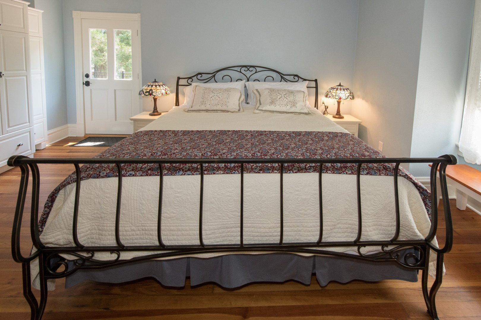 The Delphinium guest room with king bed.