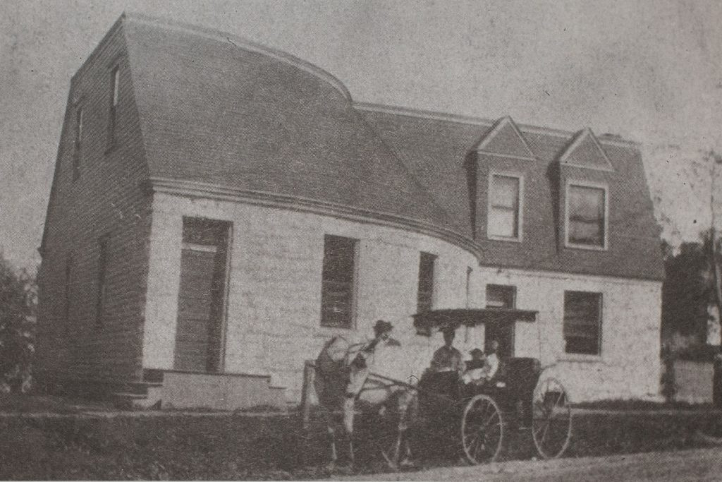 Circa 1895 Surrey parked on Bompart outside the curved sanctuary
