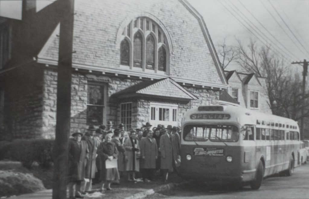 Circa 1950 Historic photo of congregants boarding a charter bus in front of the church.